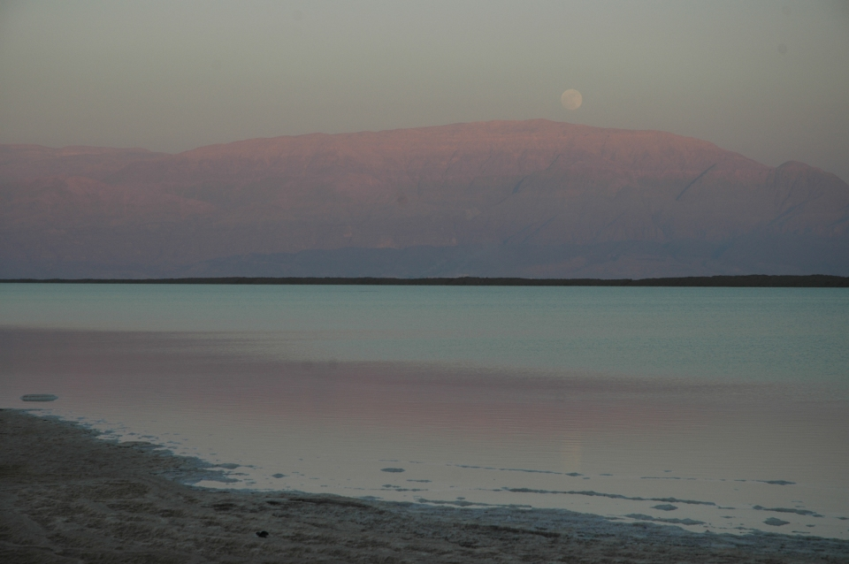 Moonrise over Dead Sea at sunset