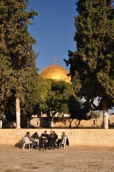 Dome of Rock and men reading Koran_048